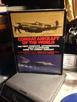 Combat Aircraft of the World from 1909 to the Present by Taylor, John W.R., editor and compiler