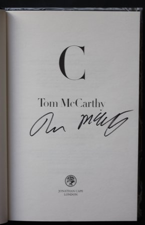 C. by McCARTHY, Tom.