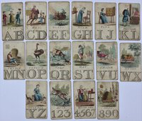 A set of sixteen engraved alphabet and number cards.