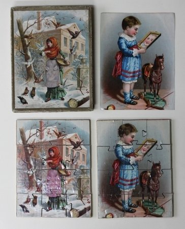 Two small wooden jigsaws contained in the original box