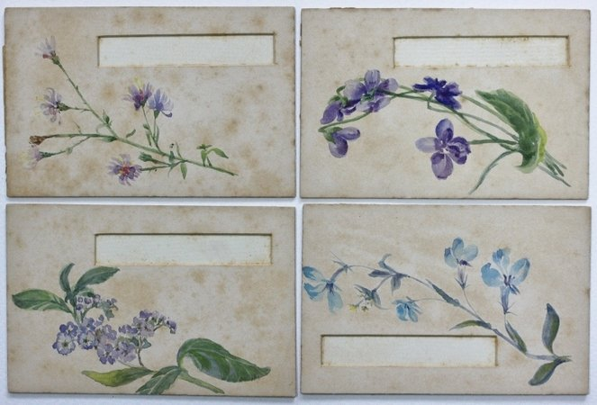 A set of 12 place-setting cards