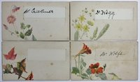 A set of 8 gilt-edged place-setting cards