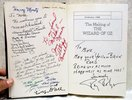 Another image of THE WIZARD OF OZ **HAND SIGNED & INSCRIBED** by the WICKED WITCH / Margaret Hamilton, the SCARECROW / Ray Bolger, and 13 MUNCHKINS by Aljean Harmetz